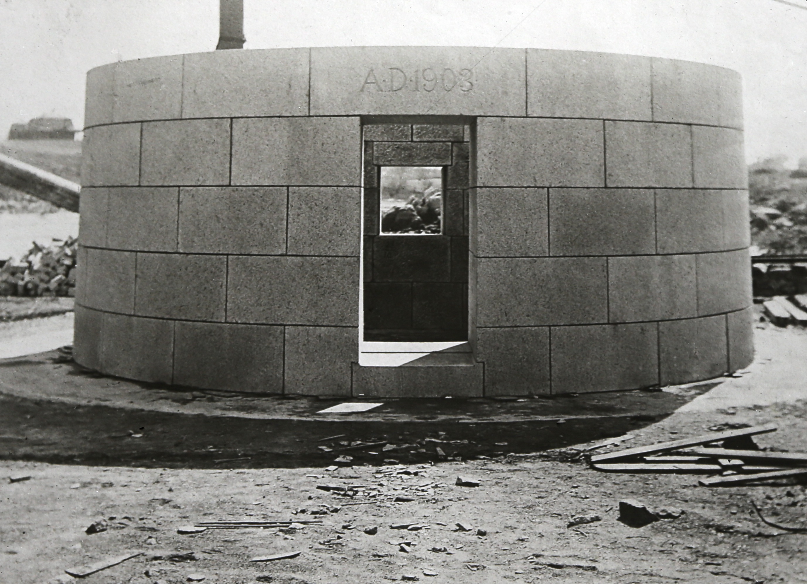 "Master stonemasons at the Rockport granite quarry pieced together each level of Graves Light before transferring them to ships for delivery to the ledge. Pictured is the entrance to the lighthouse, to be installed 40 feet above the sea. The date, ""A.D. 1903"" appears over the door. (Photo courtesy of the Massachusetts Historical Society)"