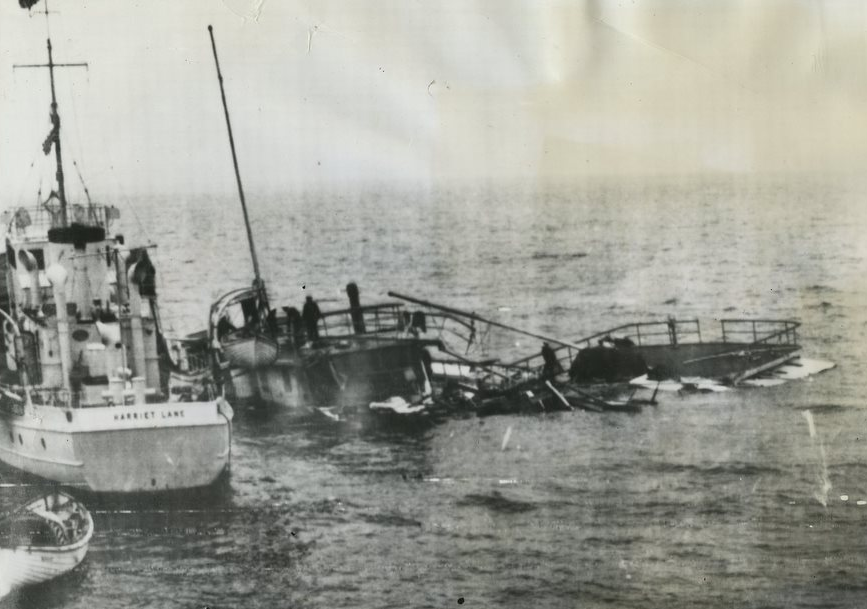 US Coast Guardsmen from the USCGC Harriet Lane search the floating wooden superstructure of the SS Romance for victims or survivors. The Boston-to-Provincetown steamship sank between Graves Light and Nahant in 1936. (Graves Light Station collection)