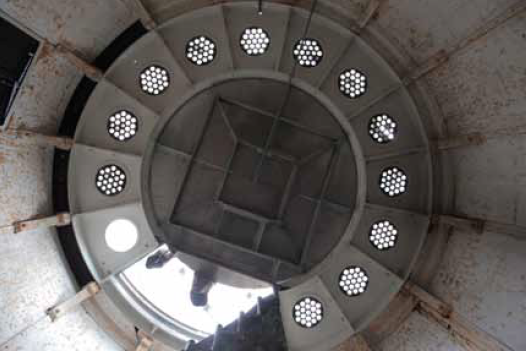The ceiling of the level below the lamp room. See the spiral staircase at about 7 o'clock in the picture. The hexagonal skylights are made of round, sun-colored amethyst glass panes. They are original.