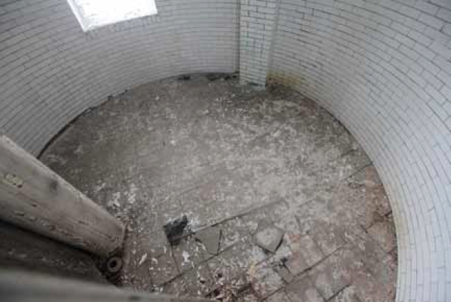 Looking down at the floor of level 3. The room is only 13 feet in diameter. This is not the original floor; we'll locate the architectural plans and ultimately will reconstruct one.