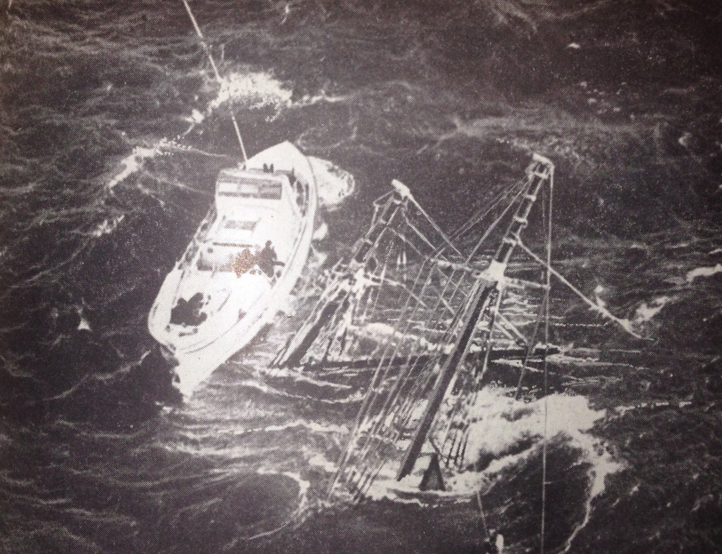 The wreck of the Mary O'Hara, with a salvage boat after the rescue of five surviving sailors. The survivors clung to the protruding masts and lines until being rescued by the North Star.