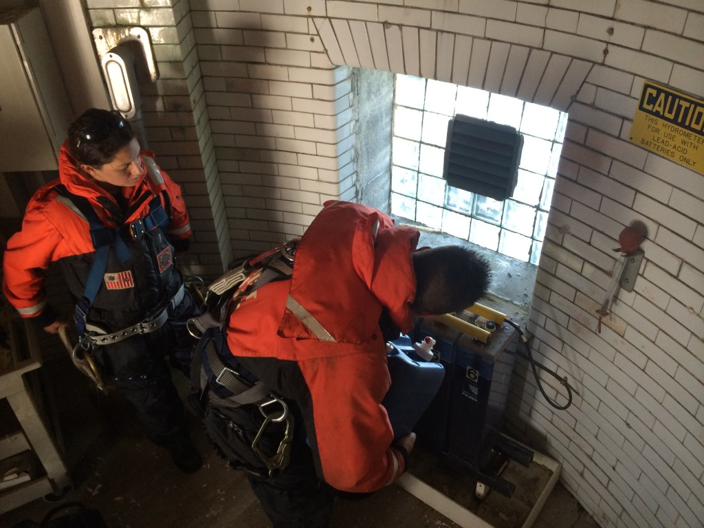 Harley and Dave of the US Coast Guard maintain the solar-powered batteries in the Graves Light watch room.