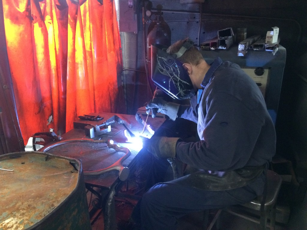 Arthur crafts exact copies of lighthouse fixtures out of bronze. He's at Mystic Valley Foundry in Somerville, Mass.