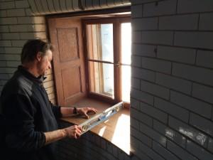Karl Phillips installs a faithful replacement of the original oak window sills.
