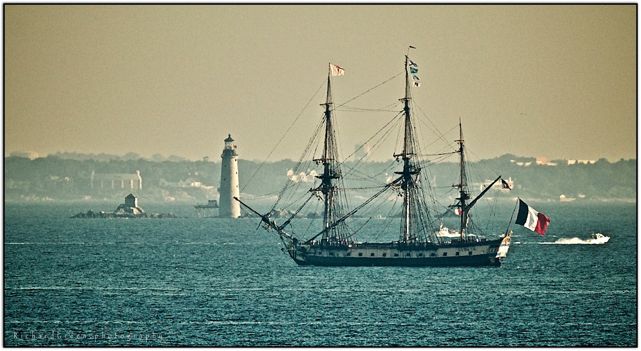 L'Hermione passes Graves Light while entering Boston Harbor. Photo by Richard Green.