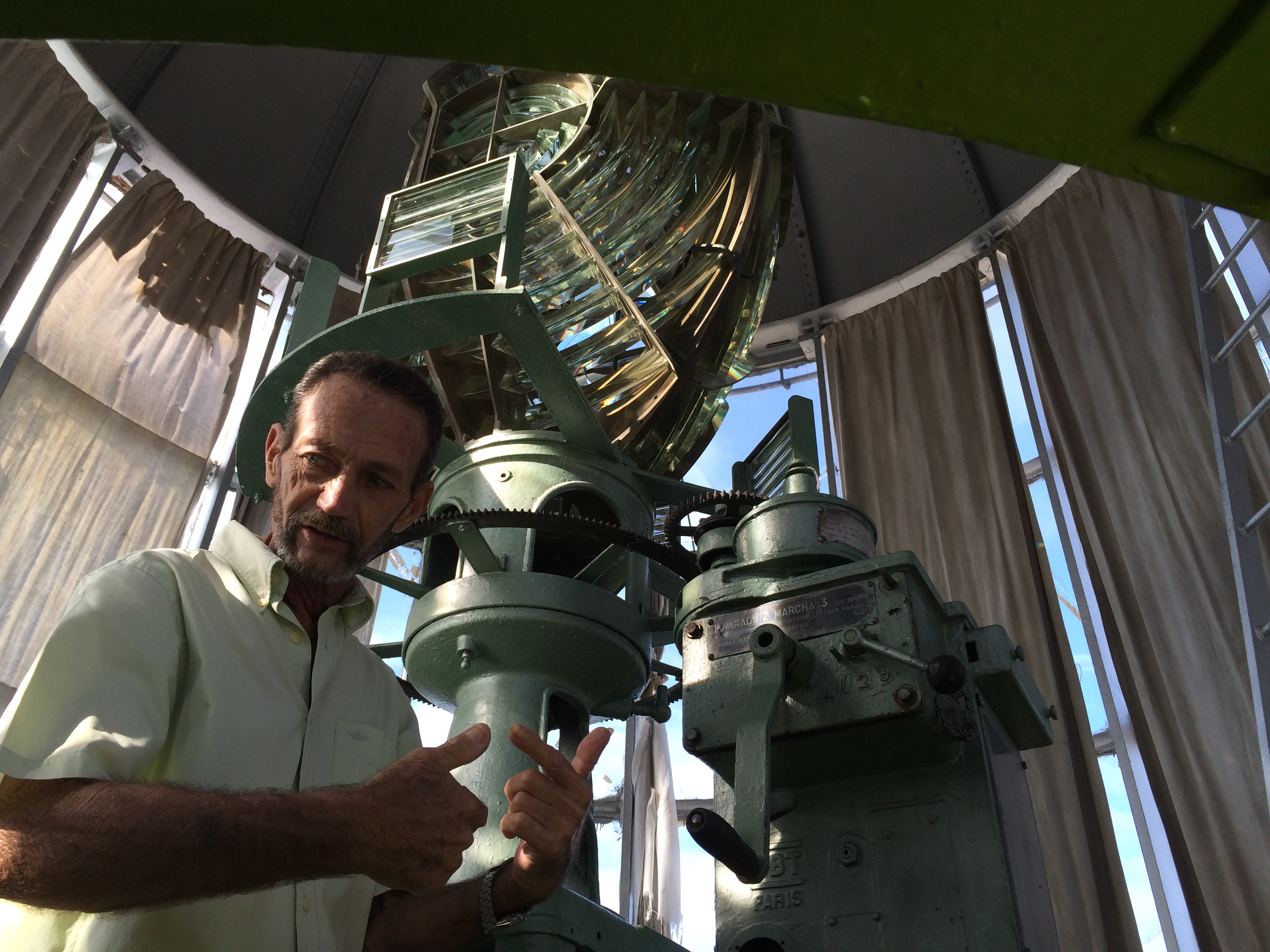 The keeper of the Castle Morro lighthouse in Havana, Cuba, shows us the original 1845 Fresnel lens.
