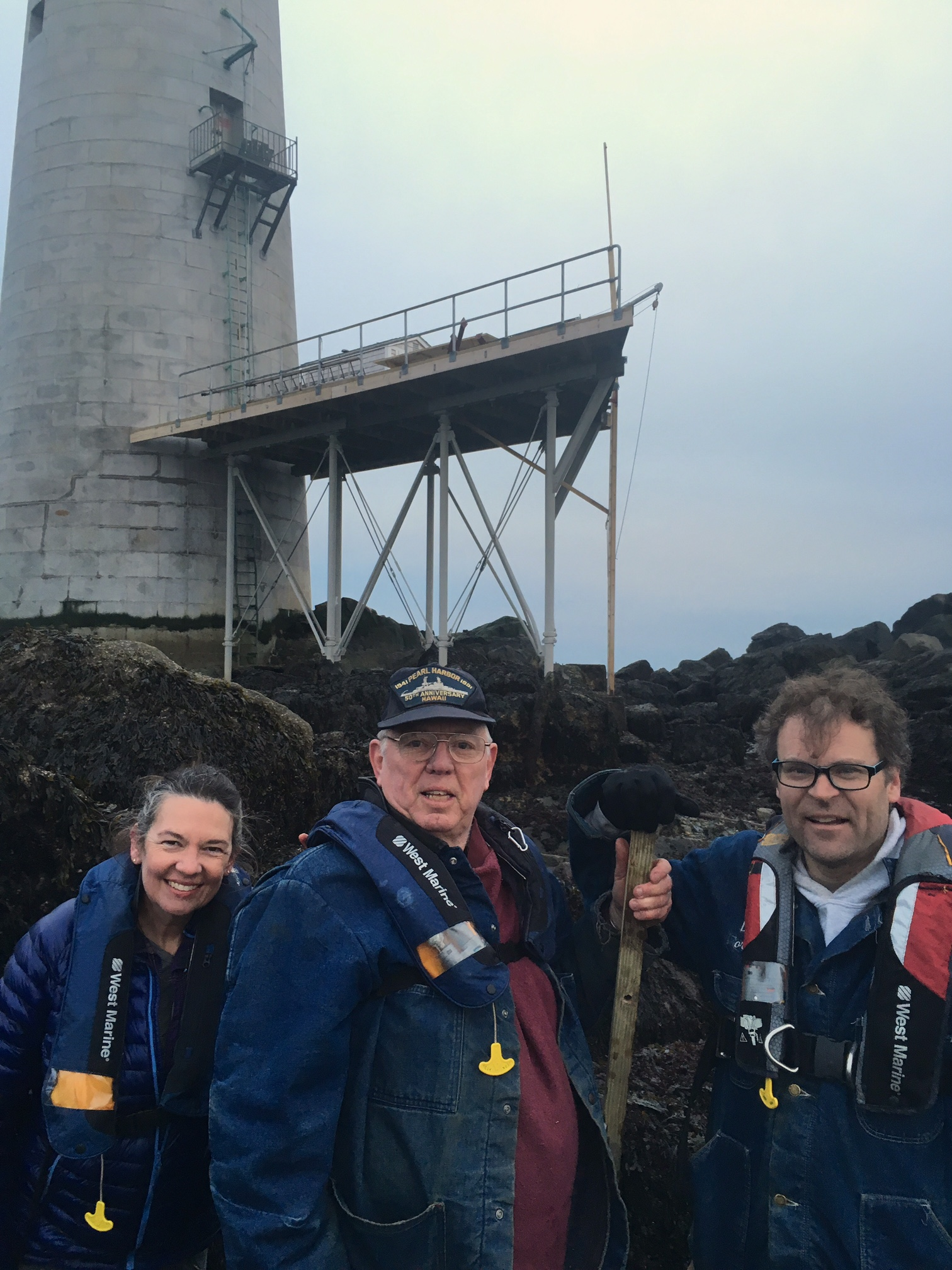 Author and speaker Art Milmore (center) on Graves Ledge at low tide with Lynn and Dave.