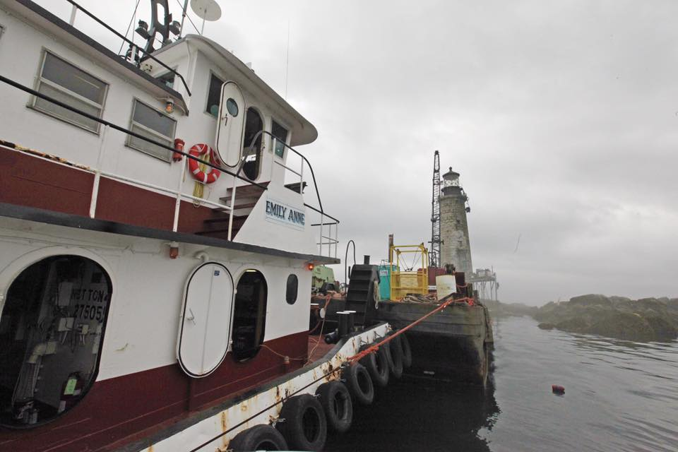 The tugboat Emily Anne as she brought a barge and crane to assist with the Graves Light restoration in 2014.