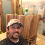 Nat of NMT Woodworking with a section of the mahogany bench set he built for our kitchen.