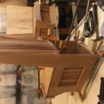 Section of the curved mahogany bench for the Graves Light kitchen, built by NMT Woodworking.